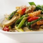 Stir Fried Sesame Vegetables with Rice - Asparagus, red bell pepper, onion, mushrooms, ginger and garlic stir-fried in peanut oil and garnished with toasted sesame seeds.  Serve over rice.