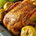 Adams Family Duck - A splendid roasted duck, stuffed with a fruity raisin stuffing, is served with an orange reduction sauce. It's the centerpiece to an unforgettable dinner.