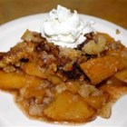 Apple Crisp I - Apple slices are dusted with cinnamon, piled into an 8-inch square pan, and topped with a crumbly flour, sugar and egg mixture, with a bit of baking powder stirred in. Then it 's dusted with sugar and cinnamon, and slipped into the oven.