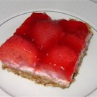 Pretzel Salad - This is an easy and decorative three layer salad consisting of a pretzel crust, a cream cheese center and a strawberry Jell-O topping. It's just plain delicious.