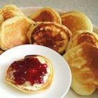 Yummy Pikelets - These pikelets are thick and fluffy. With your choice of jam and whipped cream they become out of this world!!