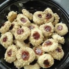 Raspberry Thumbprint Cookies - These fragile, buttery raspberry thumbprint cookies are crusted with pecans. They're delicious any time of the year but are especially perfect for the holiday season.