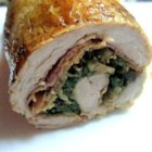 Stuffed Pork Tenderloin - Pork tenderloin is rolled around prosciutto slices with seasoned mushrooms and spinach for a flavorful main dish to impress your guests.
