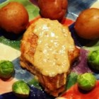Spiced Pork Chops II - Coat pork chops in a mixture of many herbs before baking with wine. Serve with homemade gravy for a tasty entree.