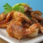 Bacon Wrapped Barbeque Shrimp - As though shrimp wrapped in crispy bacon were not tempting enough, a touch of barbeque seasoning spices things up just for fun. This makes dinner for two or appetizers for four.