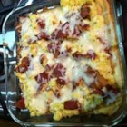 Breakfast Bacon and Sausage Pizza - Using refrigerated crescent roll for the dough, this breakfast pizza is topped with a layer of prepared salsa before being covered with scrambled eggs, bacon, slices of sausage, and Cheddar cheese.