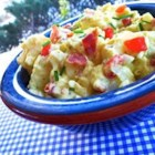 Creamy Carolina Potato Salad - Potatoes and hard-boiled eggs are coated in a creamy bacon dressing perfectly seasoned to create a potato salad that will soon become a family favorite.