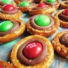 Pretzel Smoochies  - Little mini pretzels are topped with chocolate and a brightly colored candy-coated chocolate piece. You can vary the colors for all sorts of holidays.