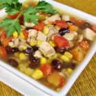 Six Can Chicken Tortilla Soup - Delicious and EASY zesty soup recipe that uses only 6 canned ingredients! Serve over tortilla chips, and top with shredded Cheddar cheese. Throw away the cans and no one will know that it is not from scratch!