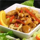 Thai Orange Chicken - Simmer chicken in a spicy, orange juice-based sauce for a quick and simple dinner. Serve alongside noodles and a green salad for a complete meal.