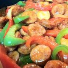 Sweet and Sour Smoked Sausage - Thinly sliced smoked sausage is quickly sauteed and then simmered with colorful bell peppers, fragrant onions and a touch of ready-made sweet and sour sauce. Add a pinch of cayenne pepper and as much hot pepper sauce as your tongue can take.
