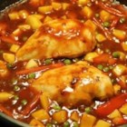 Chicken Afritada - This is an excellent chicken recipe with an interesting blend of ingredients - from soy sauce and ginger, to tomato sauce and sweet peas - best served over hot rice.