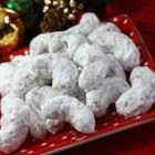 Pecan Crescents - Pecan wedding cookies rolled in confectioner's sugar.