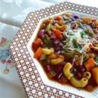 Slow Cooker Vegetarian Minestrone - Easy vegetarian minestrone soup simmered in the slow cooker is loaded with vegetables and macaroni for a warm weeknight dinner.