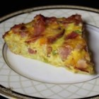 Ham and Hash Brown Quiche - Hash browns make a surprising and delicious crust in this ham and cheese quiche.