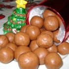 Fatty Natty's Peanut Butter Fudge Balls - Peanut butter, cocoa powder, and marshmallow creme are rolled into festive treats perfect for bake sales or holiday parties.