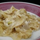 Polish Noodles (Cottage Cheese and Noodles) - This simple recipe for noodles tossed with sour cream, cottage cheese, and onion cooked in butter can be made as a side dish or a main course.
