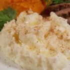 Nutmeg Mashed Potatoes - Five simple ingredients is all you need to whip up these creamy, nutmeg-flavored mashed potatoes. Serve alongside steak or at the holiday table.