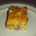Egg Casserole - I have been making this egg casserole for 13 years, primarily for Christmas brunch gatherings. It includes eggs, bread, cheese and sausage. It also works great with bacon.