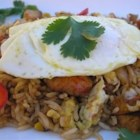 Korean Saewoo Bokkeumbap (Shrimp Fried Rice) - Cooked rice gets a delectable second life when made into Korean-style shrimp fried rice and topped with a lightly fried egg. Serve with kimchi and other Korean side dishes for an authentic taste.