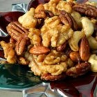 Sweet, Salty, Spicy Party Nuts - Mix walnuts, pecans, almonds, and cashews with a sweet and salty spice mixture before roasting them to crunchy perfection.