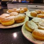 Sufganiot - Build a holiday brunch around these scrumptious homemade doughnuts. A rich yeast dough is cut into rounds, filled with sweetened cottage cheese or fruit preserves, fried in oil, and rolled in confectioners' sugar.