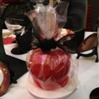 Candied Apples I - Apples perched on sticks, coated in cinnamon candy, great for Halloween!