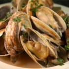 Scott Ure's Clams And Garlic - So simple, but so good - steamed clams served in their own liqueur. Serve with a crusty Italian bread, or over pasta.