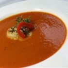 Roasted Red Pepper and Tomato Soup - Roasted peppers, tomatoes, sauteed aromatics and seasonings are cooked in chicken broth,  strained, pureed, and thickened with a roux to create this creamy soup.