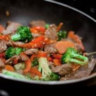 Quick Beef Stir-Fry - Busy days call for easy weeknight meals. Thin slices of beef sirloin are quickly stir-fried with colorful vegetables and soy sauce. Add some grated ginger for an extra bite.