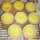 "Egg Tarts II - ""Yummy Asian egg tarts! This recipe makes 22 3-inch tarts. First, mix up a batch of shortdough pastry, then fill them  with egg custard and bake."""
