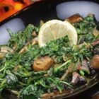 Wilted Arugula and Portobello Mushrooms - Bright, peppery arugula and portobello mushrooms cook quickly in a savory reduction of sherry and chicken broth with onions and garlic.