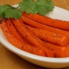 Spicy Glazed Carrots - Carrots cooked with brown sugar, cinnamon, cayenne pepper, and a hint of nutmeg make a flavorful and easy side dish that's great with fall meals.