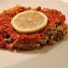 Egyptian Koshari - Lentils, rice and pasta are cooked and then served in a spicy tomato sauce. This is a typical Egyptian dish that is very good and cheap over here! Puree the sauce in a food processor if you like a smoother texture.