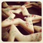 Christmas Stars - A festive sandwich style cookie. Excellent for Christmas or New years' celebrations.