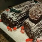 Chocolate Decadence Yule Log - This rich chocolate cake, flavored with coffee liqueur and rolled up around a cream cheese filling, is a classic Christmas dessert.