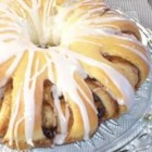 Swedish Tea Ring - This is a hand-shaped, filled yeast bread. Sprinkle toasted sliced almonds over the icing if you wish.