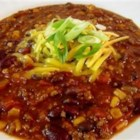 Taco Soup VI - Black and kidney beans are combined with ground beef and whole kernel corn in this tomato juice based soup with taco seasoning mix.