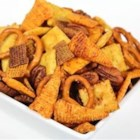 Reindeer Snack Mix - Savory, salty, crunchy, and sweet! All the flavors and textures you crave are in this interesting snack mix made from cereal, crackers, pretzels, and nuts, baked with a buttery, slightly spicy seasoning.