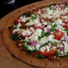 Pizza Without the Red Sauce - The sauce on this pizza is a mixture of butter, olive oil, garlic, sun-dried tomato pesto, herbs and Parmesan cheese.  It's topped with a fresh tomato, spinach, onion and feta cheese.