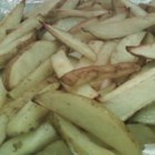 Best Baked French Fries - Potato slices are coated in garlic salt and sugar and baked into crispy, golden French fries.