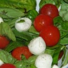 Caprese Salad - This light, fresh salad is made with fresh mozzarella, cherry tomatoes, and fresh basil. It is the perfect quick and easy accompaniment to any summer meal.