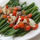 Green Beans with Almonds and Caramelized Shallots - Green beans are quickly steamed to tenderness, then mixed with sweet caramelized shallots, red bell pepper, and toasted almonds.