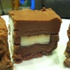 Candy-Bar Fudge - Smooth and creamy chocolate fudge encloses a layer of candy bar pieces in the middle. Use your favorite candy bars.