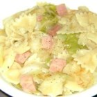 Grandmother's Polish Cabbage and Noodles - Tender cabbage, bow tie pasta, and ham combine in an easy, quick, and hearty meal with Polish origins. It's a great next-day dish to use up ham leftovers.