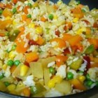 Quick Fried Rice - Cooked rice fried with egg, bacon, peas, carrots and frozen mixed vegetables.