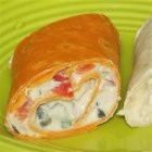 Fiesta Pinwheels - This is a festive appetizer with cream cheese, sour cream, and picante sauce wrapped in flour tortillas. Serve with salsa.