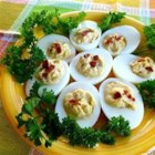 Spicy Bacon Deviled Eggs - Spicy mustard and wasabi paste give this cheesy, bacon-filled appetizer a devilish kick.