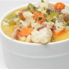 Nichole's Chicken Cauliflower Soup - This cauliflower and chicken soup is creamy and filling and made with reduced fat Parmesan cheese and skim milk. It is perfect on a cold night with a loaf of sourdough bread.