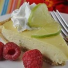 Phoenician's Key Lime Pie - Ground toasted almonds spike the crust of this delicious pie.